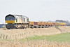 66850, originally Freightliner 66577,  leads 66413 on 6L37 Hoo Junction - Whitemoor Yard as they approach Horsemoor AHB, 24/03/14.