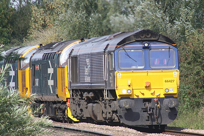 66427 emerges from the shrubbery near Badgeney Road AHB on 0Z37 Crewe Gresty Bridge - Stowmarket working with 37407 BLACKPOOL TOWER and 37401 MARY QUEEN OF SCOTS in tow, presumably a part of the RHTT fleet for the forthcoming season, 20/09/19.