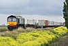 66416 in debranded DRS livery approaches Welney Road AHB  on 4M87 Felixstowe South - Crewe Basford Hall, 24/05/14.