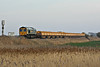 66515 trails 66951 on a rake of eastbound ballast side tippers from Whitemoor at Horsemoor, 08/03/14.