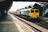 66512, fresh off the boat, heads east through March Station on 4L83 Leeds - Felixstowe, 18/11/00.