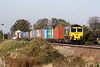 66505 heads east past Manea Signalbox on 4L90, the diverted Lawley Street - Felixstowe Liner, 15/10/11.