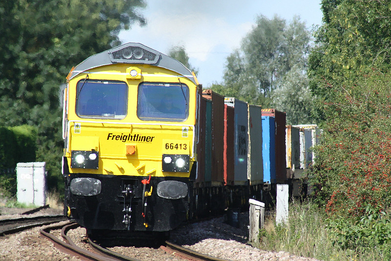 66413 shows off the new Freightliner front end as it passes Badgeney Road AHB on 4L93 Lawley Street - Felixstowe North, 31/08/18.