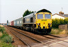 66502 heads west at Whitemoor Drove LC with a short Ipswich - Doncaster Railport liner, 05/07/06.