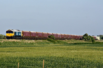 66789 BRITISH RAIL 1948-1997, erstwhile 66250, looking immaculate in Large Logo Blue livery, approaches Horsemoor AHB on 4M86 Ely North Junction - Wellingborough empty stone, apparently a trial run of 6L75 from Peak Forest, 05/06/18 - so that's what they wanted the buckeye-fitted loco's for!