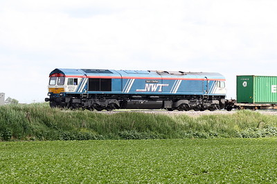66747 MADE IN SHEFFIELD in Newell & Wright Transport livery passes Horsemoor on 4M29 Felixstowe North - Birch Coppice, 10/06/21.