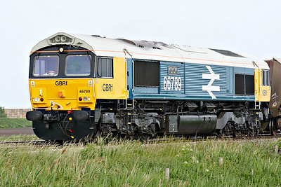 66789 BRITISH RAIL 1948-1997, erstwhile 66250, looking immaculate in Large Logo Blue livery, approaches Welney Road AHB on 4M86 Ely North Junction - Barrow Hill stone empties, 07/06/18.