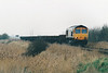 66702 heads west at Eastrea Road AHB on a train of spoil empties, 15/02/02.