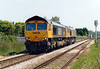 66701 slows for March West Junction as it tows 66711 towards Whitemoor Yard, 07/06/06.