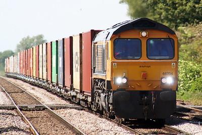 66704 COLCHESTER POWER SIGNALBOX passes Manea on 4L13 Doncaster Railport - Felixstowe North, 08/06/21.