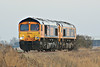 66710 PHIL PACKER and 66717 GOOD OLD BOY head for Whitemoor Yard for engineering duties passing Horsemoor, 08/03/14.