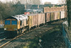 66708 rounds the bend from March Station on the Felixstowe - Hams Hall freightliner, 19/02/04.