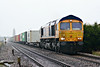 66770 approaches Whitemoor Drove in pouring rain on 4Z33 Felixstowe South - Doncaster Railport, 19/02/18.