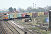 66732 rounds the curve and drops downhill into March Station on 4E33 Felixstowe North - Doncaster Railport, 31/03/14