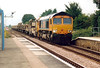 66708 heads east through Manea Station with what appears to be Whitemoor's new CWR set, 30/07/05.