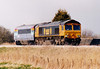 66709 JOSEPH ARNOLD DAVIES passes Horsemoor on a Doncaster - Norwich stock move with re-liveried DVT 82103, 19/03/07.
