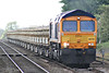 66732 approaches Manea Station with a rake of loaded ballast side-tippers from Whitemoor, bound for Colchester, 17/05/14.
