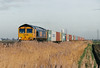 66710 passes Australia Farm No.64 OC on the Felixstowe - Selby freightliner, 27/03/07.