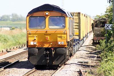 66774 passes Manea on 4E20 Felixstowe South - Rotherham Masborough, 08/06/21.