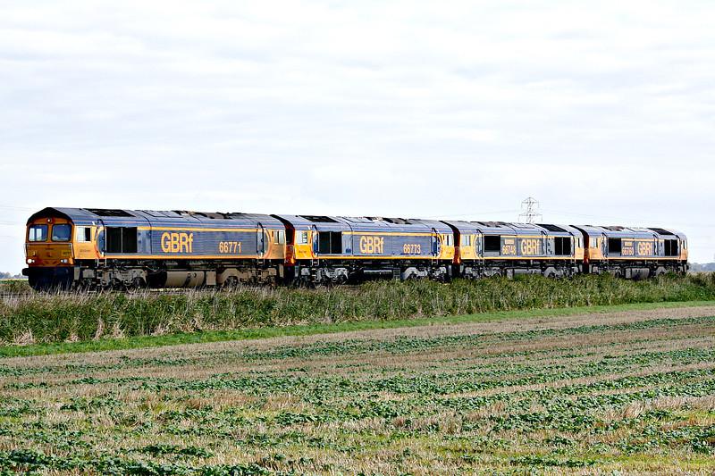 66771 leads 66773, 66748 WEST BURTON 50 and 66760 DAVID GORDON HARRIS on oH06 Whitemoor Yard - Peterborough towards Three Horseshoes No.1 AHB, 08/10/17.