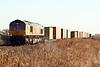 66787 approaches Welney Road AHB on 4E21 Felixstowe South - Doncaster Railport, 30/12/19.