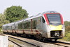 Class 755 413 Class 170 111, c/w 170 398, approaches Badgeney Road AHB on 2L75 1150 Peterborough - Ipswich, 18/09/21.