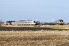Class 800 104 on 1S12 0921 Kings Cross - Edinburgh passes Three Horseshoes AHB No.1 and 66507 on a diverted Ditton - Felixstowe service, 11/01/20.