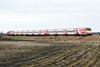 91132 is dragged by 67015 past Three Horseshoes AHB No.1 on 1S17 1121 Kings Cross - Edinburgh, 11/01/20.