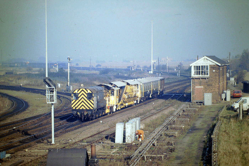 08711 passes Whitemoor Junction with a tamper for March Up Yard, 10/87. 'Rationalisation' is about to hit Whitemoor Junction at any moment.