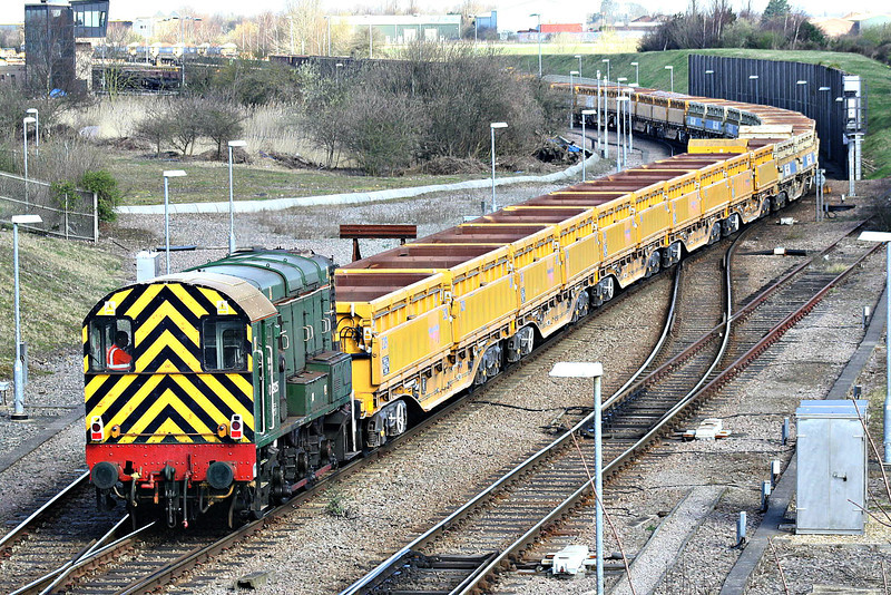 08925, one of 2 GBRF shunters at Whitemoor Yard, shunts a rake of side-tipping ballast wagons, 17/03/14.