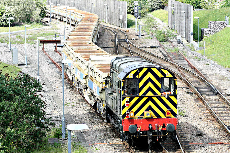09002, one of 2 GBRF shunters at Whitemoor Yard, shunts a rake of ballast side-tippers, 13/05/14.