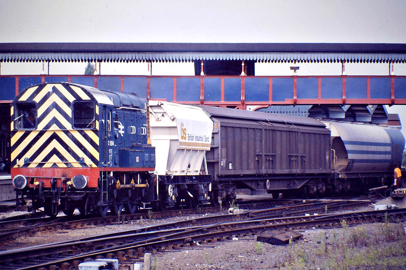 08594 heads for the Marcroft Wagon Shops in the old Goods Shed in the Down Yard with a trio of cripples, 08/88.
