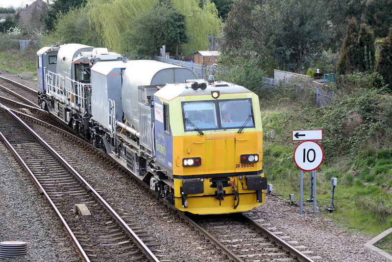 MPV 98956 leads on 6Z45 Carlisle - Stowmarket as it passes March West Junction, 01/04/11.