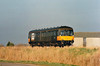Class 122 'Bubble Car' 55012 was passed into departmental stock on withdrawal  as 977941 and converted to a route learner. It passed to Loadhaul ownership and thence to EWS. It is seen here passing Horsemoor on 29/01/98 on a Stansted Branch route learner, on hire to Central Trains, prior to the reopening of the Stansted Airport Branch. The unit was withdrawn in 1998 and is now preserved.