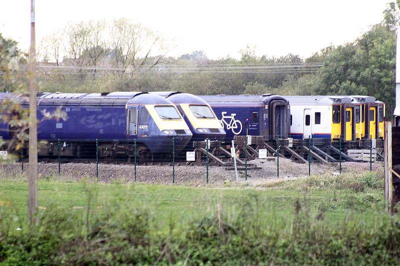Class 43 HST power car 43017 and a sister lurk in the depths of Papworth's yard at Ely North Junction with a pair of Class 317's behind them