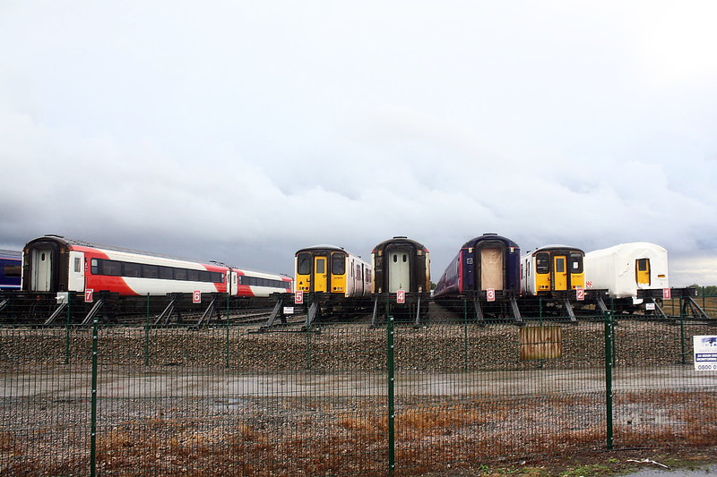 Class 317 671 and 317 6662 sit amid a sea of redundant HST stock of both GWR and LNER origin, 06/10/20.
