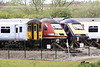 Class 317 722, previously the Porterbrook demonstrator, shares the storage sidings at Ely North Junction with ex-GWR 43191 and ex-LNER 43311, 11/05/21.