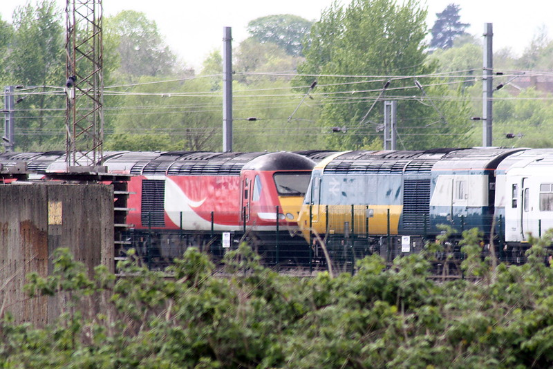 43006 in special IC livery shares the sidings at Ely North Junction with a number of it's sisters, 11/05/21.
