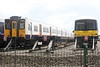 Class 317 888 in London Overground livery sits next to ex-GN 365 512 at Ely North Junction, 11/05/21.