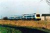 Class 170 207 passes Horsemoor on a Peterborough - Ipswich service, 11/10/99.