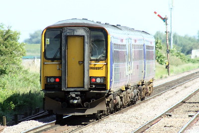 Class 153 352 trails sisters 153 351 and 153 301 through Manea on 5L41 Heaton TMD - Ely Papworths Sidings for storage, 08/06/21. Apparently, these are last of the Northern Trains units.