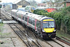 Class 170 110 slows for its March stop on the 1325 Stansted Airport - Birmingham New St., 31/03/14.