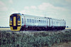 Class 158 865 passes Horsemoor on a Norwich train still wearing it's Alpha Line livery, 15/07/88.