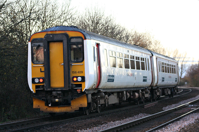 Class 156 409, usually employed on Norwich area local services, passes Badgeney Road AHB as 5Z15 Norwich Crown Point - Doncaster West Yard, 26/11/16.