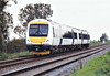 Class 170 399, on hire to Central Trains, heads east through Chettisham on a Norwich train, 10/11/06.