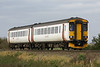 Class 156 418 ESTA 1965-2015 approaches Welney Road AHB on 2L17 1350 Peterborough - Ipswich, 22/10/17.