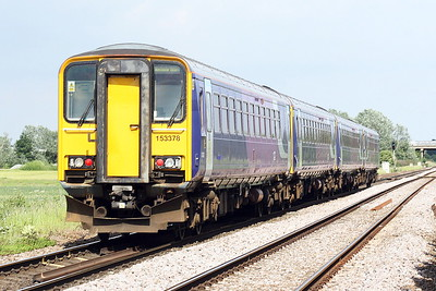 Class 153 378 trails on 5L41 Heaton TMD - Ely Papworth's Sidings past Whitemoor Drove with sisters 153 315, 153 304 and 153 317 ahead, 07/06/21. As far as I am aware, these are the first Northern Trains units to go into store at Ely.