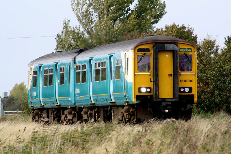 Class 150/2 - 150 280 - in Arriva Trains Wales livery heads east past Horsemoor as 5Z30 Cardiff Canton - Norwich Crown Point transfer working, 04/10/11, showing Rhymney in the headcode panel.