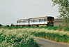 Class 150 229 heads east past Horsemoor on a Peterborough - Ipswich service, 14/05/98.