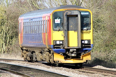 Class 153 374 in debranded EMT livery approaches Badgeney Rd AHB on 5E46 Cardiff Canton - Ely North Junction working, bound for store at Papworth's, 15/02/21. The unit, which had been in store at Papworth's since last July, had been on loan to TfW.